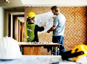 construction-team-working-on-a-blueprint